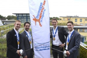 Die Gold-Säbelfechter Benedikt Wagner, Matyas Szabo, Nicolas Limbach und Max Hartung (v. l.) fordern die Dormagener auf, am 30. August mitzumachen. FOTO: ON